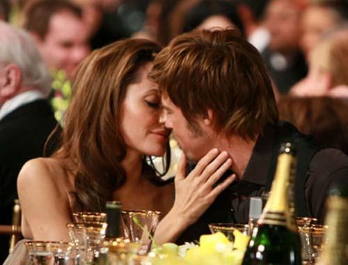 Actors Angelina Jolie and Brad Pitt backstage at the TNT/TBS bro
